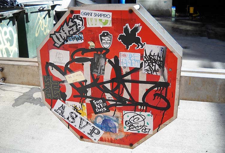 Graffiti covered stop sign